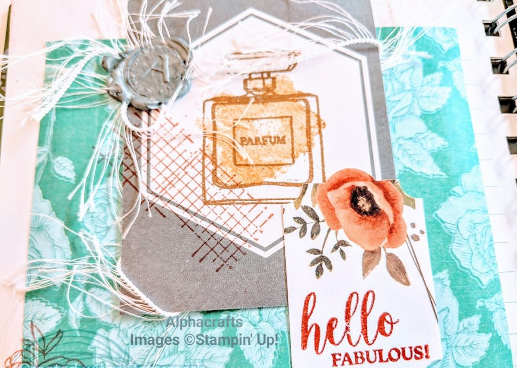 Journal page with perfume bottle image from Stampin' Up!, wax seal and fringe ribbon.