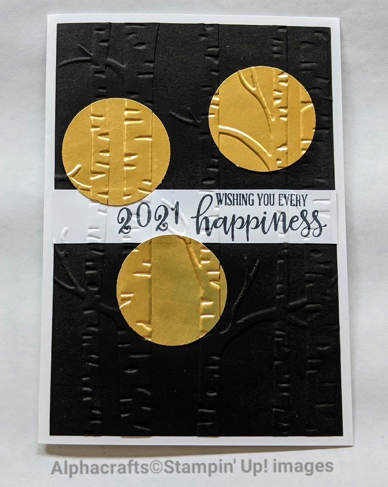 Card featuring gold foil circles over woodland embossing folder.