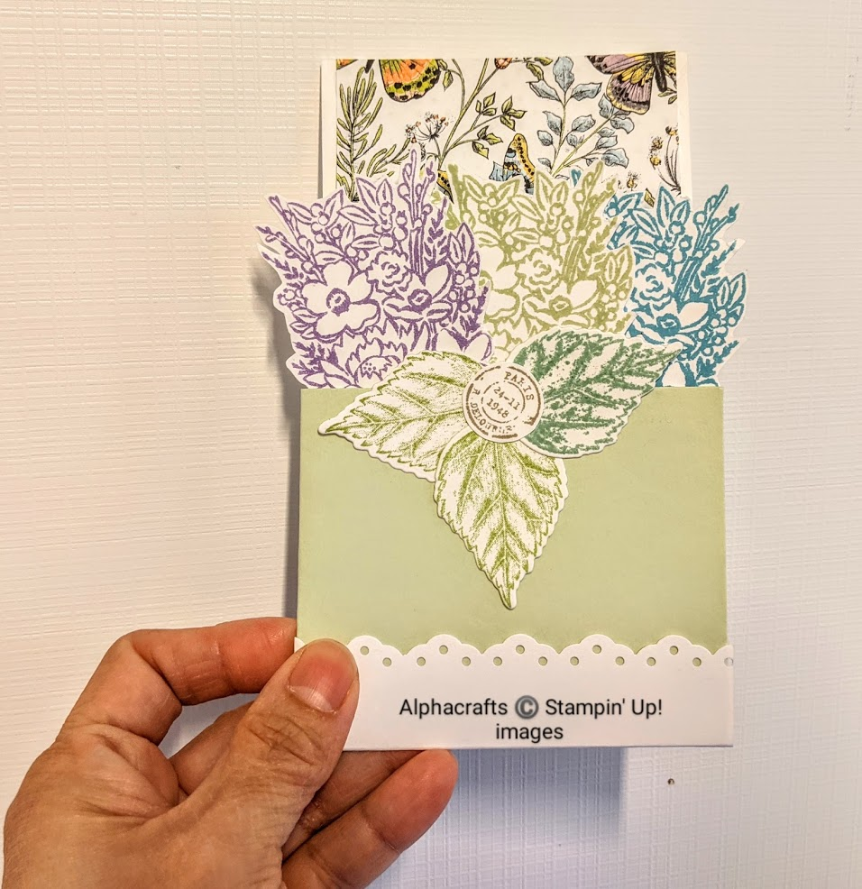 Image of card in a plant box.