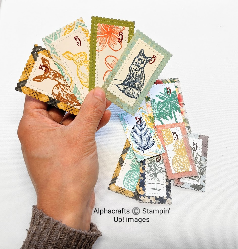 Faux postage stamps, handstamped with animals and botanical images.